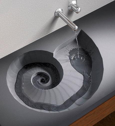 Умывальник-раковина в форме окаменелости моллюска аммонита
